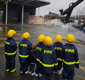 Little firefighters watching a demonstration of the Stinger