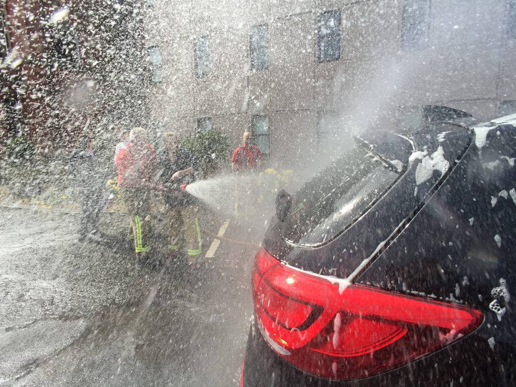 Firefighters Washing a Car
