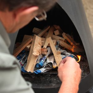 Man Lighting Chiminea