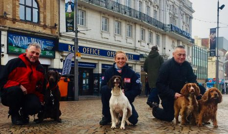 Dogs with their handlers outside Winter Gardens in Blackpool