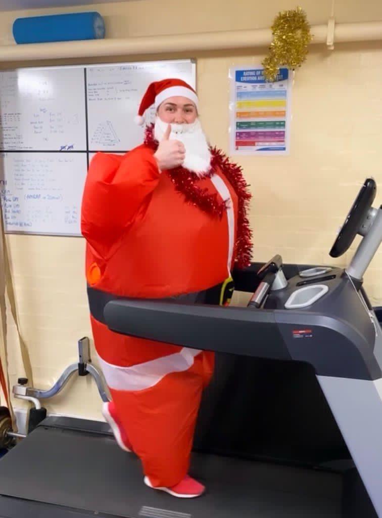 Runner Wearing Santa Claus Suit