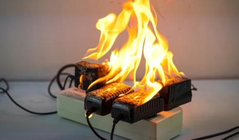 overloaded plug socket on fire