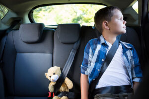 child wearing seatbelt