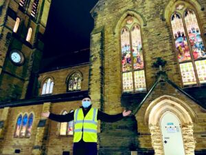 picture of Faz Patel stood outside cathedral getting ready to volunteer