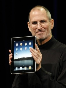 Steve Jobs with the new Apple iPad